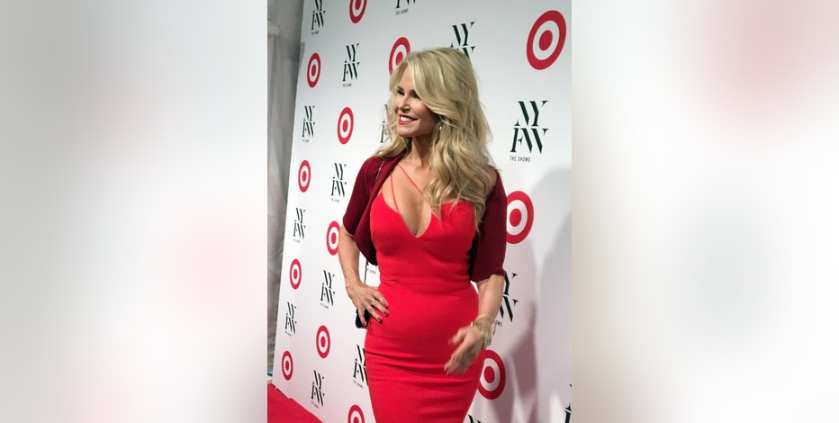 Christie Brinkley arrives at Target's custom-built piano lounge for New York Fashion Week, Tuesday, Sept. 6, 2016, in New York. Target's custom-built bar on West 33rd Street will be open to the public from Thursday through Saturday (AP Photo/Anne D'Innocenzio)