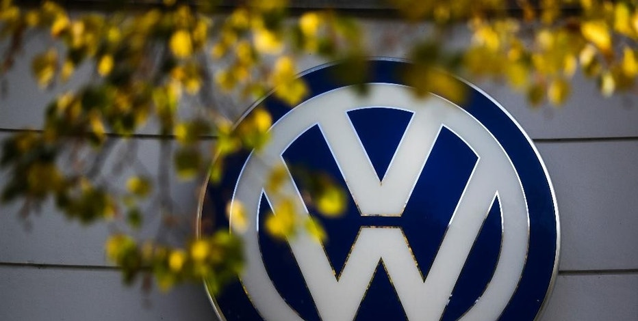 FILE - In this Oct. 5, 2015, file photo, the VW sign of Germany's Volkswagen car company is displayed at the building of a company's retailer in Berlin. Volkswagen Truck & Bus, an arm of the German automaker Volkswagen, is buying a minority stake in Navistar. The two companies also said Tuesday, Sept. 6, 2016, that they will enter a procurement joint venture that will help source parts for both businesses. (AP Photo/Markus Schreiber, File)