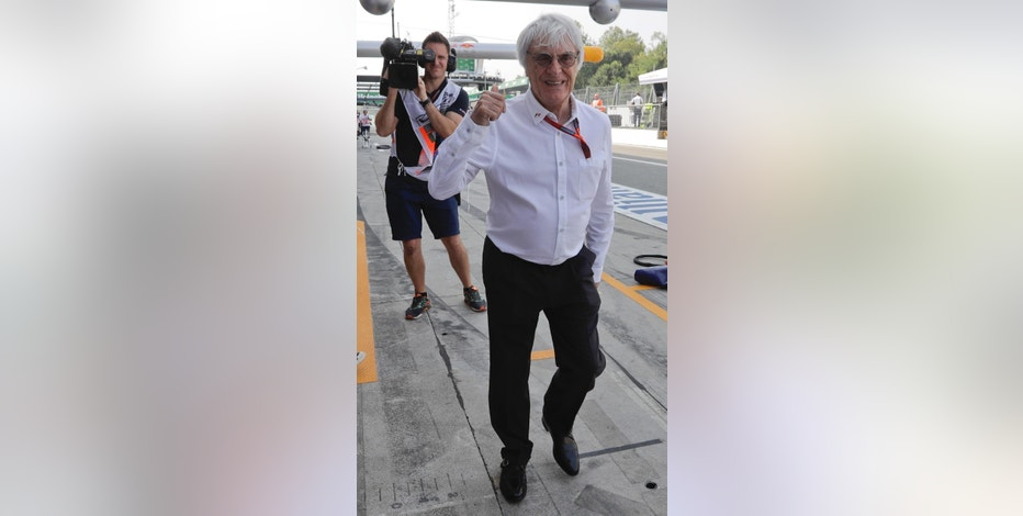 Chief Executive for the Formula One Group, Bernie Ecclestone, gives the thumb-up sign during the first practice session for Sunday's Italian Formula One Grand Prix at the Monza racetrack, Italy, Friday, Sept. 2, 2016. (AP Photo/Luca Bruno)