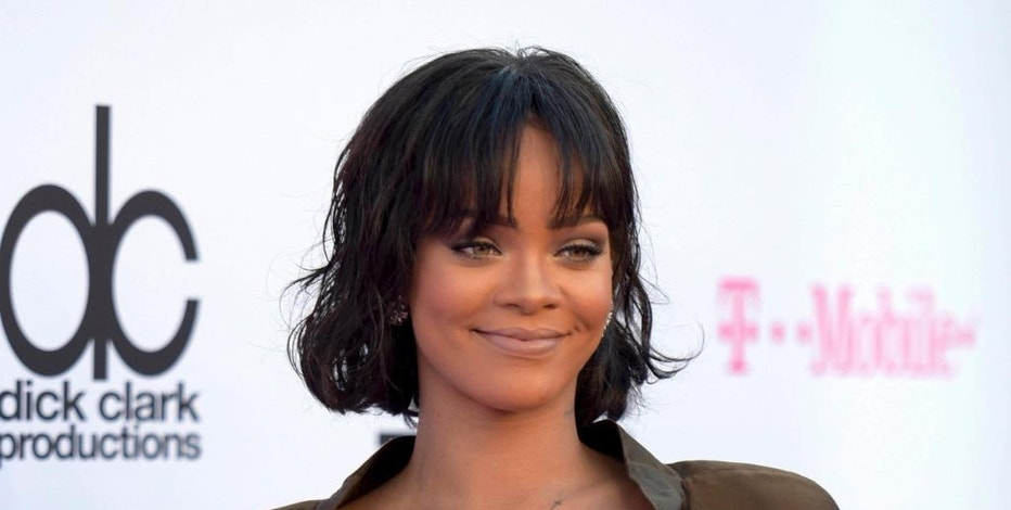 FILE - In this May 22, 2016 file photo, Rihanna arrives at the Billboard Music Awards in Las Vegas. Rihanna says her new collection for Puma was inspired by Japanese street culture. The pop star launched the autumn/winter 2016 Fenty Puma by Rihanna line on Tuesday, Sept. 6, 2016 at Foot Locker in New York City. (Photo by Richard Shotwell/Invision/AP, File)