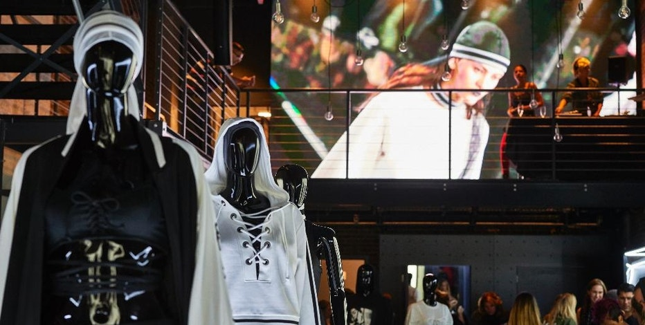"Invited customers seen looking at Rihanna's ""FENTY""  x Puma collection at the Pop-Up Shop Opening on Tuesday, Sept. 6, 2016 in New York (Photo by Robert Altman/Invision/AP)"