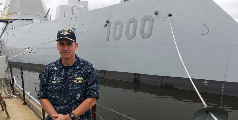 Capt. James Kirk, skipper of the future USS Zumwalt, stands in front of the destroyer at Bath Iron Works on Tuesday, Sept. 6, 2016, in Bath, Maine. The ship is due to depart the shipyard on Wednesday to be commissioned in Baltimore. (AP Photo/David Sharp)