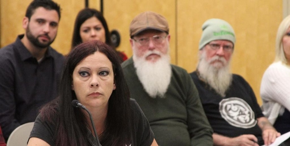 Destiny Neade of Fairbanks appears before the Alaska Marijuana Control Board on Thursday, Sept. 8, 2016, in Anchorage, Alaska. Neade and her husband, Nick, received the first ever permit for a marijuana retail store in Alaska during the board meeting.  (AP Photo/Mark Thiessen)