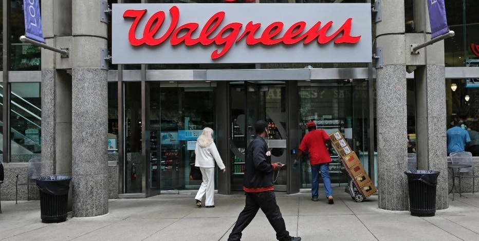 FILE - This June 4, 2014, file photo, shows a Walgreens retail store in Boston. Walgreens said Thursday, Sept. 8, 2016, it will probably have to unload more stores than originally expected in order to ease regulatory concern about its pending acquisition of Rite Aid, a deal valued at more than $9 billion that will make the nation's largest drugstore chain even bigger. (AP Photo/Charles Krupa, File)