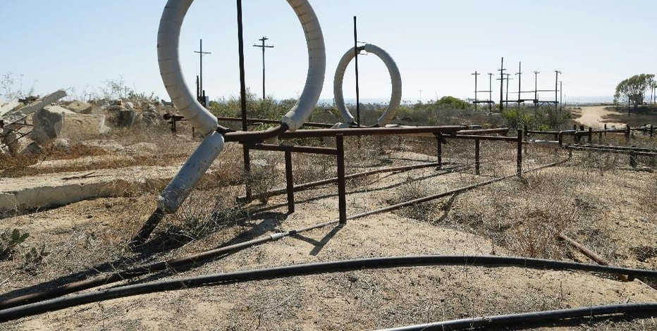 FILE - This Aug. 18, 2016 file photo shows what remains of an oil-extraction operation in Banning Ranch, on what is believed to be the biggest piece of privately-owned vacant land on Southern California's coast in Newport Beach. The California Coastal Commission will hold a hearing in Newport Beach on Wednesday, Sept. 7, 2016, on the plan to build 895 homes, a 75-room hotel and retail complex on the 401-acre site long used for oil drilling. (AP Photo/Nick Ut, File)