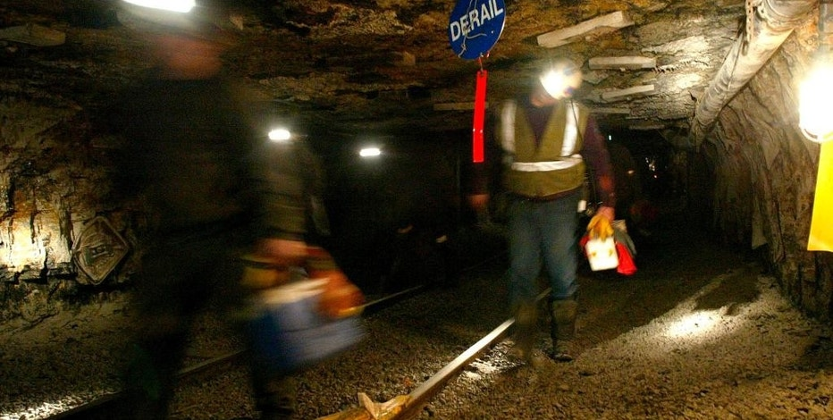 FILE - In this March 10, 2006 file photo, Ohio coal miners head into the mine for a shift inside the Hopedale Mine near Cadiz, Ohio. An election-year bill that would protect health-care and pension benefits for more than 100,000 retired coal miners is dividing coal-state Republicans. Thousands of miners are expected to gather at the Capitol to push for the measure, which they describe as life-saving and fulfilling a promise the government made in 1946.  (AP Photo/Joe Maiorana, File)