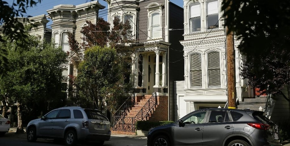 "FILE - This May 27, 2016 file photo shows a Victorian home, center, made famous by the television show ""Full House."" The home is now available to rent for $13,950 a month. The 1883 villa was put on the market in May with a $4.15 million price tag, but it didn't sell. (AP Photo/Eric Risberg,File)"