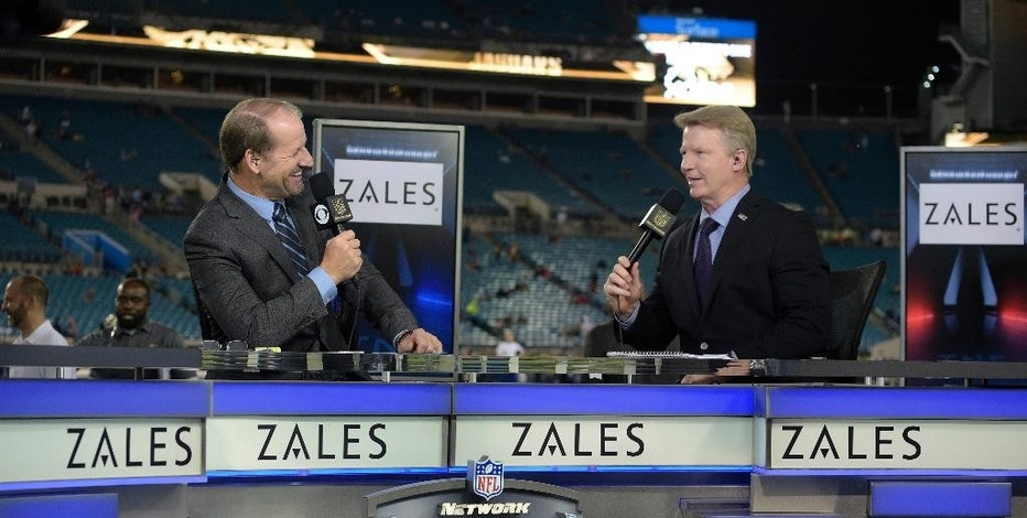 FILE - In this Nov. 19, 2015, file photo, Thursday Night Football sportscasters Bill Cowher, left, and Phil Simms broadcast from the set on the field before an NFL football game between the Jacksonville Jaguars and the Tennessee Titans in Jacksonville, Fla. Every single NFL football game will be shown online during the 2016 season for the first time, but they come with plenty of requirements and restrictions. (AP Photo/Phelan M. Ebenhack, File)