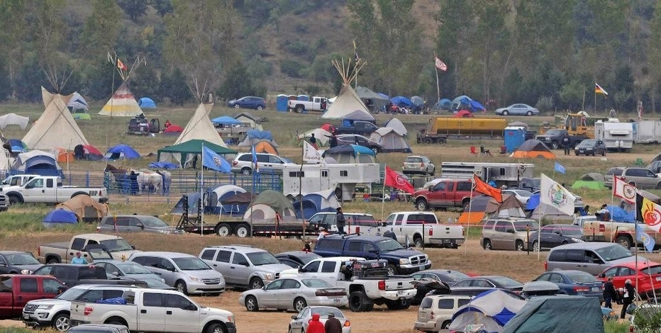 The Sacred Stones Overflow Camp is growing in size and number as more people arrive at the site along North Dakota Highway 1806 and across the Cannonball River from the Standing Rock Sioux Indian Reservation, Monday, Sept. 5, 2016 in Morton County, N.D.  (Tom Stromme/The Bismarck Tribune via AP)