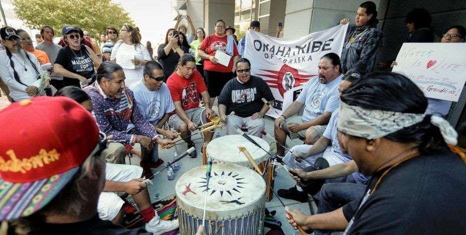 Members of the Ponca, Santee, Winnebago and Omaha Tribes in Nebraska and Iowa along with others participate gather during a rally on Thursday, Sept. 8, 2016, in front of the Army Corps of Engineers offices in Omaha, Neb., to protest against the Dakota Access Pipeline in the Dakotas and Iowa. (AP Photo/Nati Harnik)