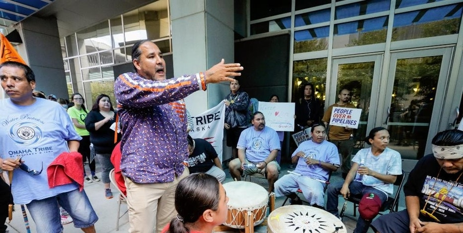 Sam Grant of the Omaha tribe addresses members of the Ponca, Santee, Winnebago and Omaha Tribes in Nebraska and Iowa along with others during a rally on Thursday, Sept. 8, 2016, in front of the Army Corps of Engineers offices in Omaha, Neb., to protest against the Dakota Access Pipeline in the Dakotas and Iowa. A judge is expected to rule Friday on whether to block construction of the pipeline that is supposed to pass close to the tribal reservation near the North Dakota-South Dakota border.  (AP Photo/Nati Harnik)