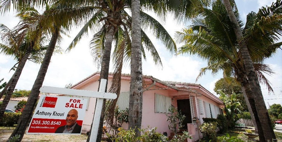 FILE - This Monday, April 11, 2016, file photo shows a home for sale in Surfside, Fla. On Thursday, Sept. 8, 2016, Freddie Mac reports on the week's average U.S. mortgage rates. (AP Photo/Wilfredo Lee, File)