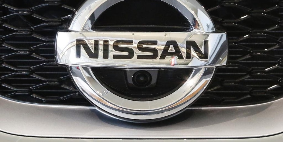 FILE - This Feb. 11, 2016, photo shows a Nissan emblem on a 2016 Nissan automobile at the Pittsburgh International Auto Show in Pittsburgh. Nissan is recalling over 120,000 cars and SUVs in the U.S. because brake fluid could leak and cause fires. In some cases owners should park their vehicles outside until they are fixed. The recall covers certain 2015 to 2017 Murano SUVs and 2016 to 2017 Maxima large cars that are equipped with intelligent cruise control. Also included are some 2015 and 2016 Murano hybrids.  (AP Photo/Gene J. Puskar)