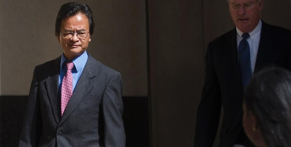 Volkswagen engineer James Robert Liang, left, leaves court, Friday, Sept. 9, 2016, in Detroit, after pleading guilty to one count of conspiracy in the company's emissions cheating scandal, Liang has agreed to cooperate in the widening criminal investigation. (Virginia Lozano/Detroit News via AP)