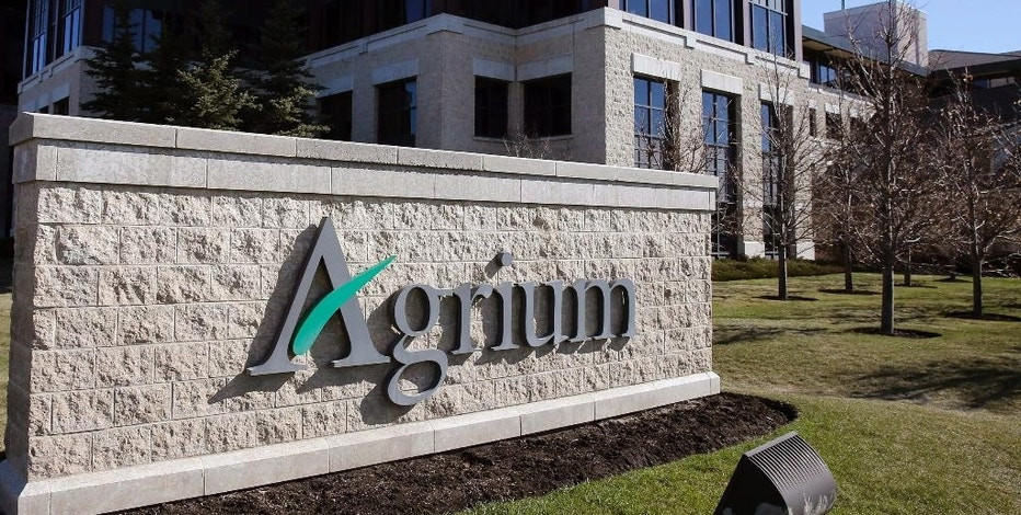 This Wednesday, May 7, 2014, photo shows Agrium's headquarters in Calgary, Alberta, Canada. Potash Corp. of Saskatchewan Inc. and Agrium said Monday, Sept. 12, 2016, that they are combining to create a new Canadian fertilizer company. A name for the new company will be announced before the deal closes in the middle of 2017. (Larry MacDougal/The Canadian Press via AP)