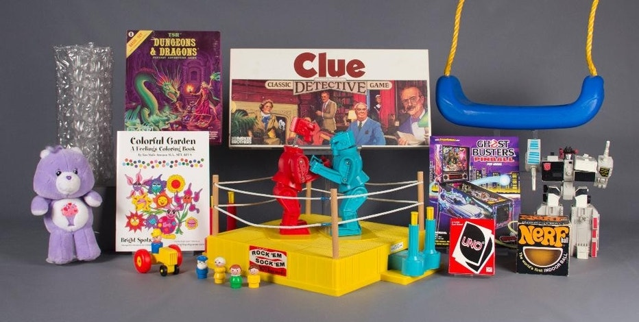 In this Aug. 10, 2016 photo provided by The Strong museum in Rochester, N.Y., are the 12 finalists for the class of 2016 for induction into the National Toy Hall of Fame: bubble wrap, Care Bears, Clue, coloring books, Dungeons & Dragons, Fisher-Price Little People, Nerf, pinball, Rock 'Em Sock 'Em Robots, swing, Transformers, and Uno. The winners will be chosen with input from a national selection committee and inducted on Nov. 10. (The Strong National Toy Hall of Fame via AP)