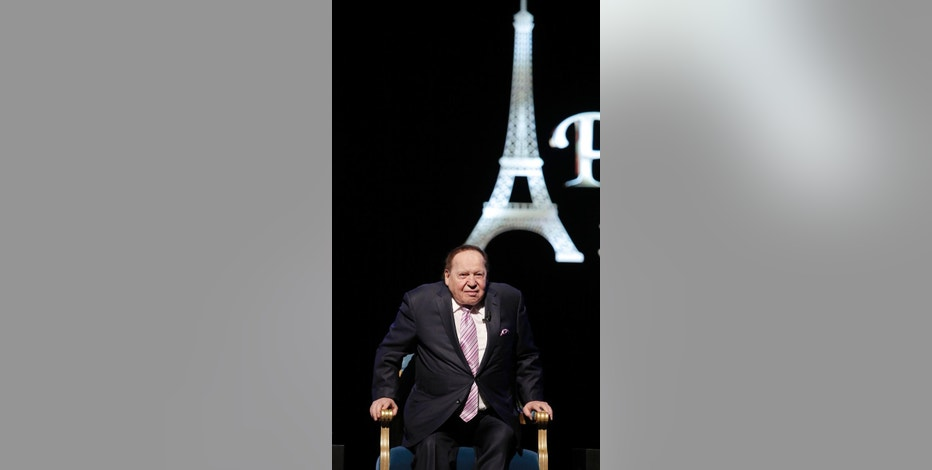 U.S. billionaire Sheldon Adelson takes a seat for a press conference for the opening of Parisian Macao in Macau, Tuesday, Sept. 13, 2016. Adelson was set to throw open the doors Tuesday to the French-themed Parisian Macao, the mogul's fifth property in the former Portuguese colony. (AP Photo/Kin Cheung)