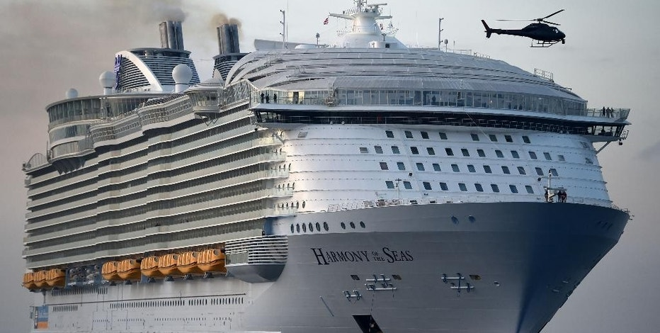 FILE - In this May 17, 2016 file photo, the world's largest passenger ship, MS Harmony of the Seas, owned by Royal Caribbean, makes her way up Southampton Water into Southampton, England. A crewmember on the world's largest cruise ship has died and four others were injured when a lifeboat fell from the deck into the water during a rescue drill, the operator and officials in the French port of Marseille said Tuesday. Julien Ruas, a deputy mayor of Marseille, told the AP Tuesday that the lifeboat fell 10 meters (33 feet) or so from the fifth deck of the ship into the sea with the five crew members aboard. He identified the dead crewmember as a 42-year-old Filipino. Circumstances of the accident are still unclear. (Andrew Matthews/PA via AP, file)