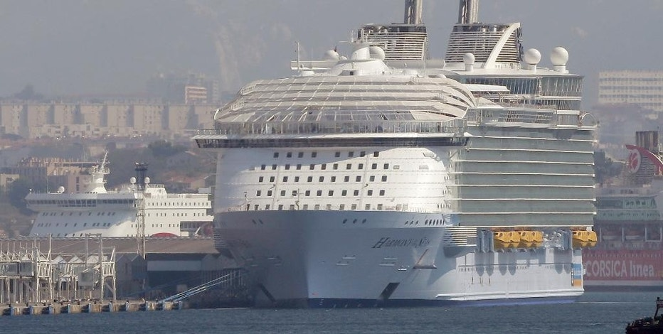The Harmony of the Seas is docked in Marseille harbor, southern France, Tuesday, Sept. 13, 2016. Royal Caribbean cruise line says a crewmember has died during a lifeboat drill being conducted in Marseille. According to tweets, four other crewmembers received medical treatment following the incident on the Harmony of the Seas. (AP Photo/Claude Paris)