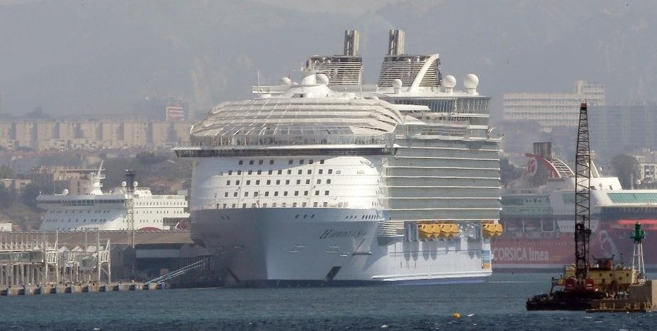 The Harmony of the Seas is docked in Marseille harbor, southern France, Tuesday, Sepr. 13, 2016. Royal Caribbean cruise line says a crewmember has died during a lifeboat drill being conducted in Marseille. According to tweets, four other crewmembers received medical treatment following the incident on the Harmony of the Seas. (AP Photo/Claude Paris)