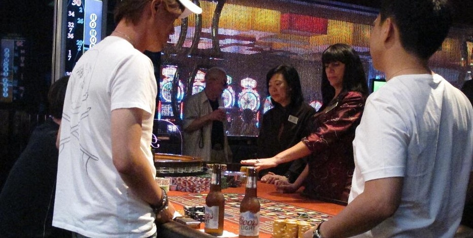 This June 24, 2016 photo shows gamblers playing roulette at the Golden Nugget casino in Atlantic City, N.J.  New Jersey voters are being promised that millions of dollars in new funding will flow to programs for senior citizens, the horse racing industry and to help a struggling Atlantic City — if only they approve a ballot question authorizing two new casinos in the northern part of the state near New York City.  (AP Photo/Wayne Parry)
