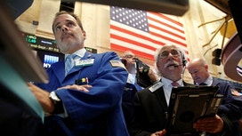Wall St Slides Over 1%, Led by Financials, Energy Stocks
