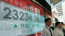 Asian shares mostly down on worries about global growth, Fed