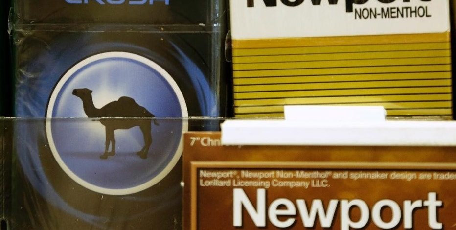 FILE - In this Tuesday, July 15, 2014, file photo, Camel and Newport cigarettes are displayed for sale in Doral, Fla. Cigarette maker Reynolds American announced Thursday, Sept. 15, 2016, that former House Speaker John Boehner, a longtime smoker, is joining its board of directors. Reynolds American Inc. is the company behind Camel, Newport and Pall Mall cigarettes. (AP Photo/Lynne Sladky, File)