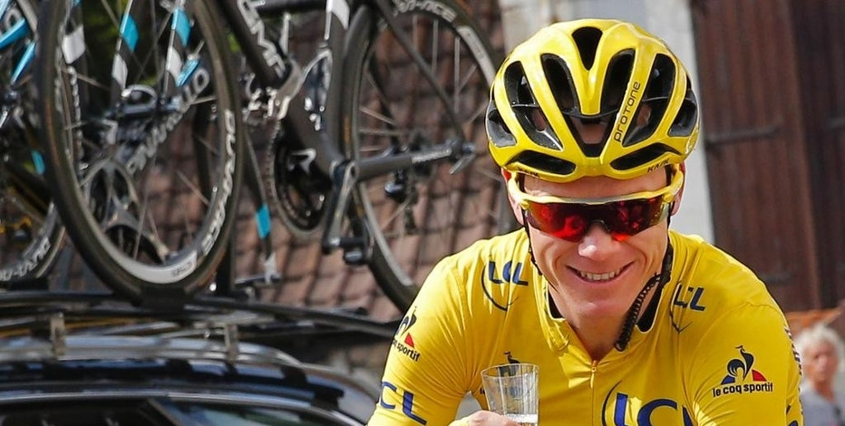 """FILE - This is a Sunday, July 24, 2016  file photo of Britain's Chris Froome, wearing the overall leader's yellow jersey, celebrates with a glass of champagne during the twenty-first stage of the Tour de France  in Paris. Three-time Tour de France winner Chris Froome  siad Thursday Sept. 15, 2016, has """"no issue"""" with his medical data being leaked, in an alleged criminal attack by Russian hackers on a World Anti-Doping Agency database. (AP Photo/Christophe Ena, File)"""