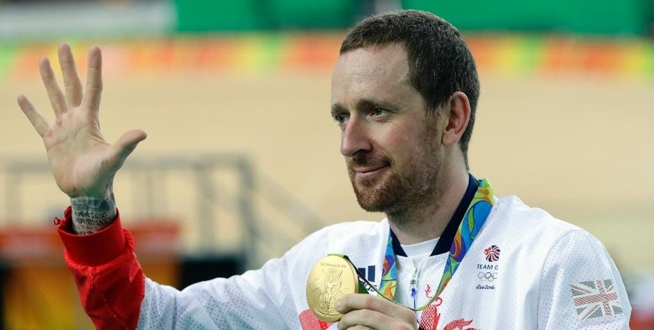 """FILE - This is a Friday, Aug. 12, 2016 file photo of Gold medalist Bradley Wiggins of Britain as he poses on the podium of the Men's team pursuit final at the Rio Olympic Velodrome during the 2016 Summer Olympics in Rio de Janeiro, Brazil. Medical data being leaked, in an alleged criminal attack by Russian hackers on a World Anti-Doping Agency database leaked details of asthma medication used by Bradley Wiggins. """"There's nothing new here,"""" a statement issued on behalf of Wiggins said. """"Everyone knows Brad suffers from asthma; his medical treatment is BC (British Cycling) and UCI (International Cycling Union) approved.""""(AP Photo/Pavel Golovkin, file)"""