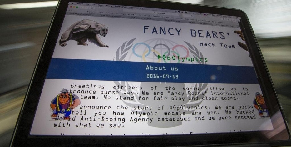 """A screenshot of the Fancy Bears website fancybear.net seen on a computes screen in Moscow, Russia, Wednesday, Sept. 14, 2016. Confidential medical data of gold medal-winning gymnast Simone Biles, seven-time Grand Slam champion Venus Williams and other female U.S. Olympians was hacked from a World Anti-Doping Agency database and posted online Tuesday Sept 13, 2016. WADA said the hackers were a """"Russian cyber espionage group"""" called Fancy Bears. (AP Photo/Alexander Zemlianichenko)"""