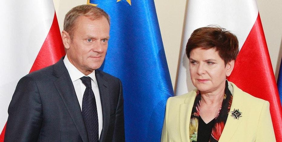 Poland's Prime Minister Beata Szydlo,right, greets European Council President Donald Tusk prior to talks on EU future after Britain leaves, in Warsaw, Poland, Tuesday, Sept. 13, 2016. Ahead of EU summit on Friday, Szydlo says EU needs deep, bold reforms. Relations between Szydlo, a conservative, and Tusk, Poland's former centrist prime minister, are tense. (AP Photo/Czarek Sokolowski)