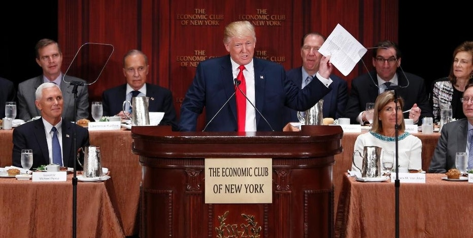 Republican presidential candidate Donald Trump holds up his notes as he speaks at a luncheon for the Economic Club of New York in New York, Thursday, Sept. 15, 2016. (AP Photo/Seth Wenig)