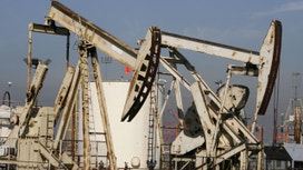 Oil Hits Multi-Week Lows on Glut Worry, Gasoline Surges