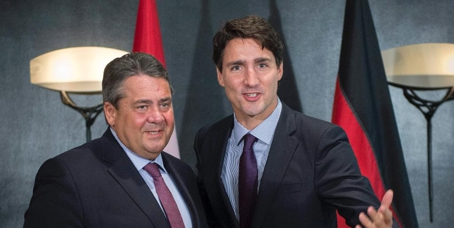 Canada Prime Minister Justin Trudeau, right, meets with Sigmar Gabriel, Germany's Minister of Economic Affairs and Energy and Vice Chancellor, at the Global Progress conference Thursday, Sept. 15, 2016, in Montreal. (Paul Chiasson/The Canadian Press via AP)