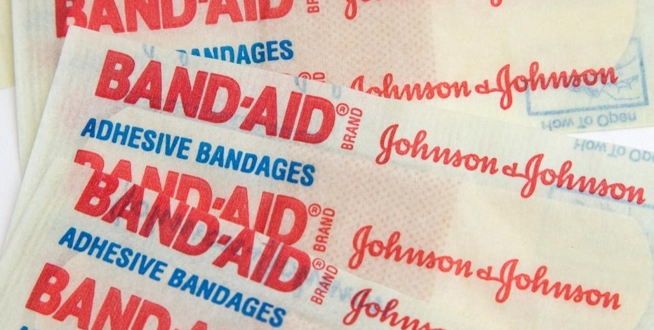 This Tuesday, Sept. 13, 2016, photo, shows Johnson & Johnson Band-Aid brand bandages in Surfside, Fla. Johnson & Johnson said Friday, Sept. 16, that it is paying more than $4.3 billion in cash to buy the eye health unit of Abbott Laboratories as it seeks to boost its vision business. (AP Photo/Wilfredo Lee)