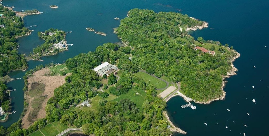 In this May 25, 2016, aerial photo provided by Stanley Jesudowich, a 63-acre estate sits on Great Island in Long Island Sound in Darien, Conn. The property went on sale Thursday, Sept. 15, 2016, with an asking price of $175 million. Industry experts said that would easily break a record for the most ever paid for a residential property in the United States. Since about 1900, the property has belonged to the family and descendants of William Ziegler, an industrialist who made his fortune in baking powder. (Stanley Jesudowich/David Ogilvy & Associates Realtors via AP)