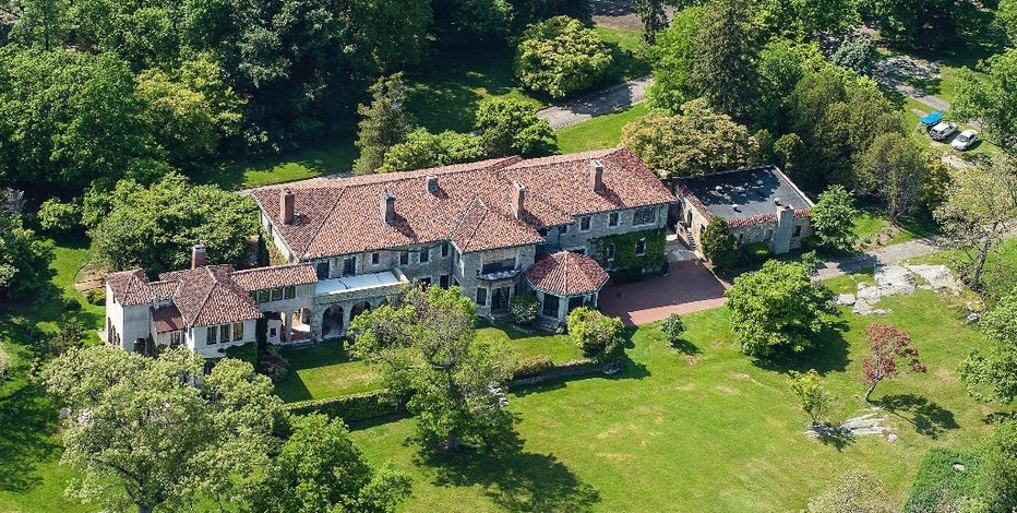 In this May 25, 2016, aerial photo provided by Stanley Jesudowich, one of the homes of a 63-acre estate sits on Great Island in Long Island Sound in Darien, Conn. The property went on sale Thursday, Sept. 15, 2016, with an asking price of $175 million. Industry experts said that would easily break a record for the most ever paid for a residential property in the United States. Since about 1900, the property has belonged to the family and descendants of William Ziegler, an industrialist who made his fortune in baking powder. (Stanley Jesudowich/David Ogilvy & Associates Realtors via AP)