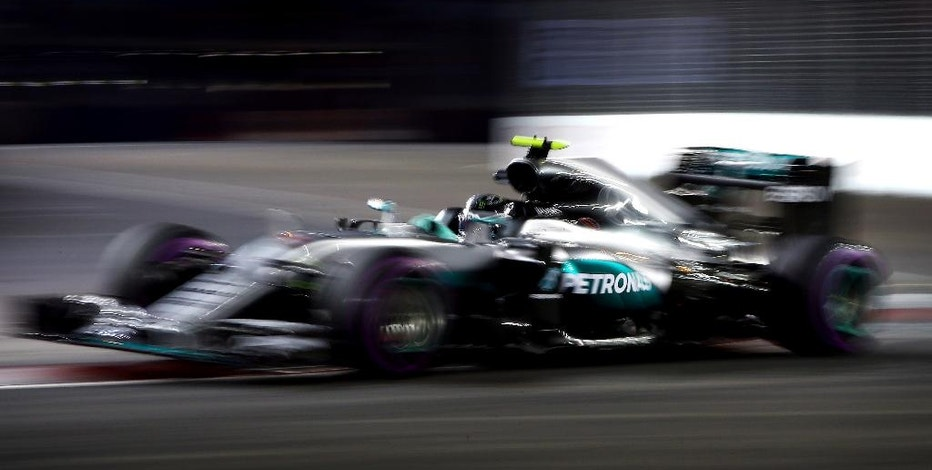 Mercedes driver Nico Rosberg of Germany steers his car during the second practice session for the Singapore Formula One Grand Prix on the Marina Bay City Circuit Singapore, Friday, Sept. 16, 2016. (AP Photo/Yong Teck Lim)