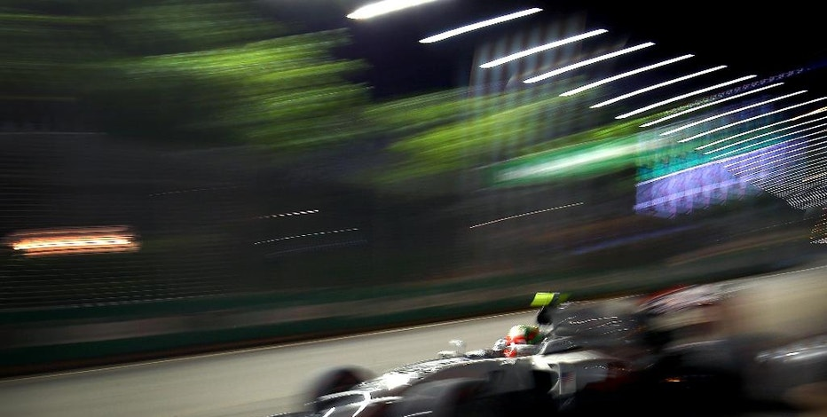Haas driver Esteban Gutierrez of Mexico steers his car during the second practice session for the Singapore Formula One Grand Prix on the Marina Bay City Circuit Singapore, Friday, Sept. 16, 2016. (AP Photo/Yong Teck Lim)