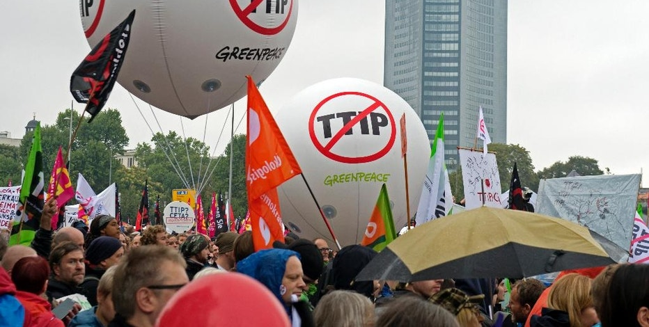 People demonstrate against the TTIP and CETA trade agreements in Leipzig, Germany, Saturday, Sept. 17, 2016. Thousands of people are rallying in cities across Germany to protest against planned European Union trade deals with the United States and Canada. (AP Photo/Jens Meyer)