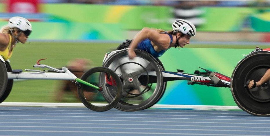 Tatyana McFadden of the U.S. races to victory in the women's 5000m T54 race at the 2016 Paralympic Games in Rio de Janeiro, Brazil, on Thursday, Sept. 15, 2016. She claimed her third gold medal and fourth overall of the games. (Antonella Crescimbeni/Penn State University via AP)