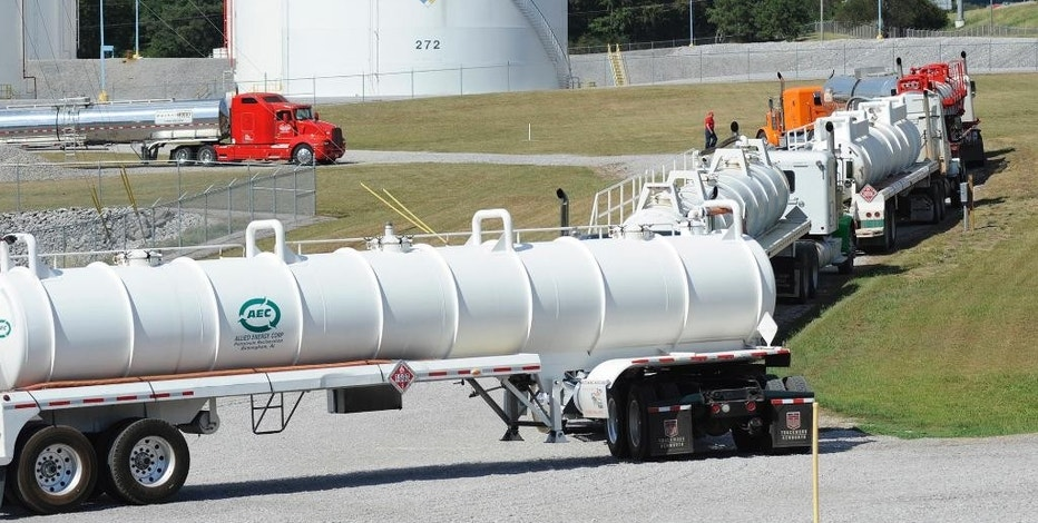 Tanker trucks line up at a Colonial Pipeline Co. facility in Pelham, Ala., near the scene of a 250,000-gallon gasoline spill on Friday, Sept. 16, 2016. The company says spilled gasoline is being taken to the storage facility for storage. Some motorists could pay a little more for gasoline in coming days because of delivery delays. (AP Photo/Jay Reeves)