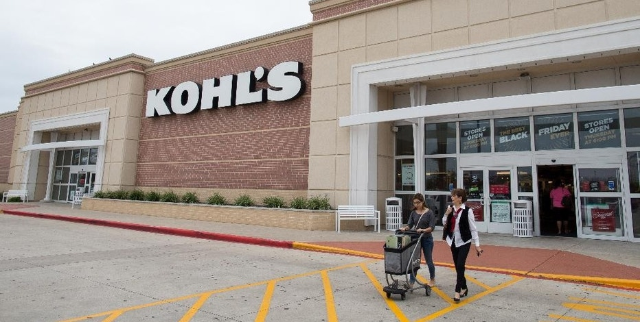 FILE - In this Nov. 27, 2015, file photo, shoppers push a cart of items as they leave Kohl's in Corpus Christi, Texas. Kohl's plans to hire more than 69,000 additional workers for the 2016 holiday season to meet demand at more than 1,100 stores nationwide. (Courtney Sacco/Corpus Christi Caller-Times via AP, File)