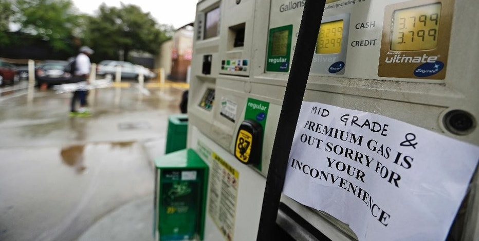 A gas station displays a sign informing customers it is out of certain grades of gasoline in Atlanta, Sunday, Sept. 18, 2016. Colonial Pipeline said it is beginning construction of a temporary pipeline that will bypass a leaking section of its main gasoline pipeline in Shelby County, Ala. Fuel supplies in at least five states, Alabama, Georgia, Tennessee and the Carolinas, were threatened by the spill, and the U.S. Department of Transportation ordered the company responsible to take corrective action before the fuel starts flowing again. (AP Photo/David Goldman)