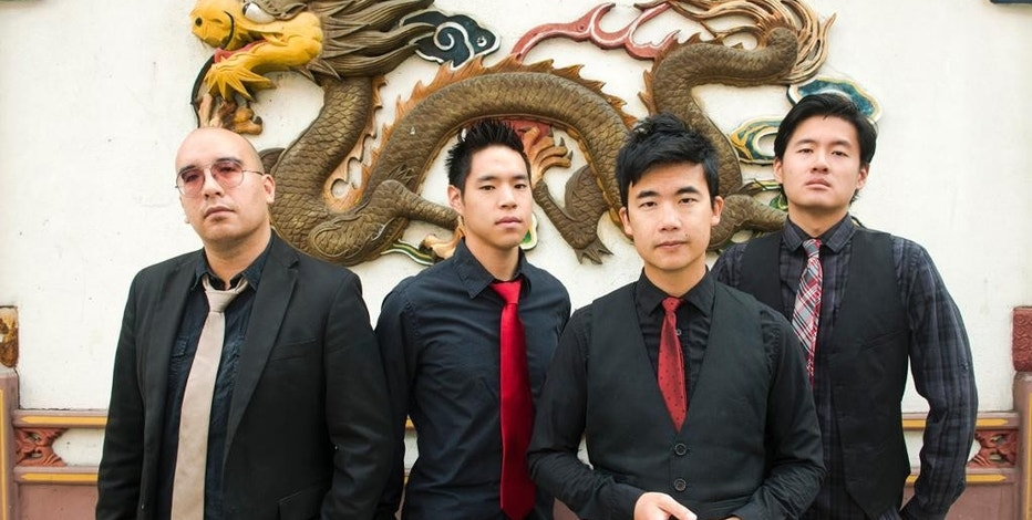 "This photo provided by Anthony Pidgeon, taken Aug. 21, 2015, shows the Asian-American band The Slants, from left, Joe X Jiang, Ken Shima, Tyler Chen, Simon ""Young"" Tam, Joe X Jiang in Old Town Chinatown, Portland, Ore. The Supreme Court could decide as early as this month whether to hear the dispute involving the Portland, Oregon-area band. And if the Washington Redskins football team has its way, the justices could hear both cases in its new term.  (Anthony Pidgeon/Redferns via AP)"
