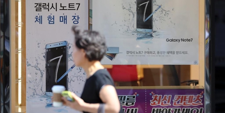 A woman walks by an advertisement of the Samsung Electronics Galaxy Note 7 smartphone in Seoul, South Korea, Monday, Sept. 19, 2016. Samsung said Monday it is investigating reports that two Galaxy Note 7 smartphones caught fire in China, where the company previously said all phones for sale were safe and didn't need to be included in a global recall. (AP Photo/Lee Jin-man)