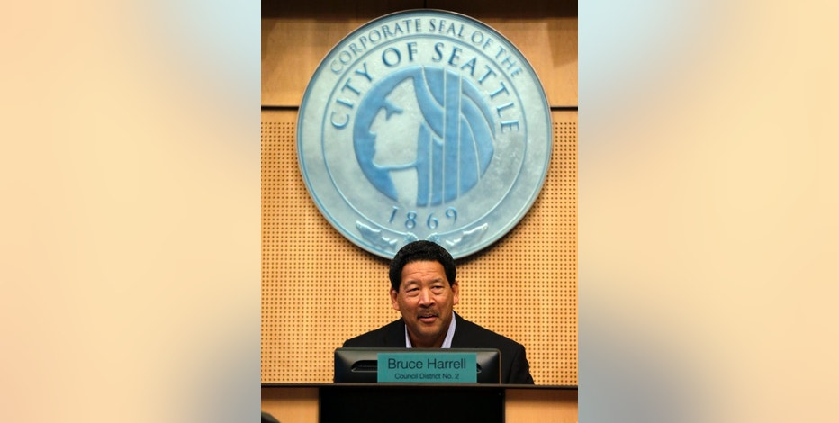 Seattle City Council President Bruce Harrell opens a meeting, Monday, Sept. 19, 2016, in Seattle. The Council was to vote Monday on new scheduling rules for hourly retail and food-service employees, including requiring employers to schedule shifts 14 days in advance and pay workers extra for certain last-minute scheduling changes. (AP Photo/Elaine Thompson)