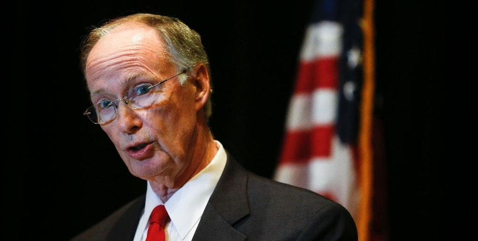 """Alabama Gov. Robert Bentley speaks to the media during a news conference, Monday, Sept. 19, 2016, in Hoover, Ala. Bentley issued a state of emergency in Alabama after a pipeline spill near Helena, Ala. Gas prices spiked and drivers found """"out of service"""" bags covering pumps as the gas shortage in the South rolled into the work week, raising fears that the disruptions could become more widespread. (AP Photo/Brynn Anderson)"""