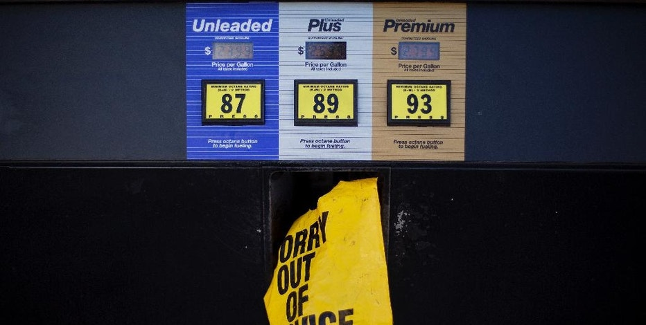"A gas pump is covered with a plastic bag during a fuel outage at a station in Smyrna, Ga., Monday, Sept. 19, 2016. Gas prices spiked and drivers found ""out of service"" bags covering pumps as the gas shortage in the South rolled into the work week, raising fears that the disruptions could become more widespread. Georgia Gov. Nathan Deal issued an executive order Monday aimed at preventing price gouging. (AP Photo/David Goldman)"